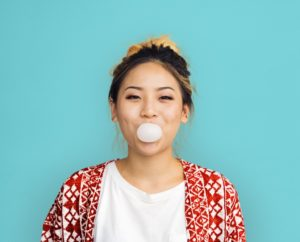 Young girl chewing bubble gum
