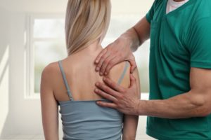 a woman getting a massage sitting