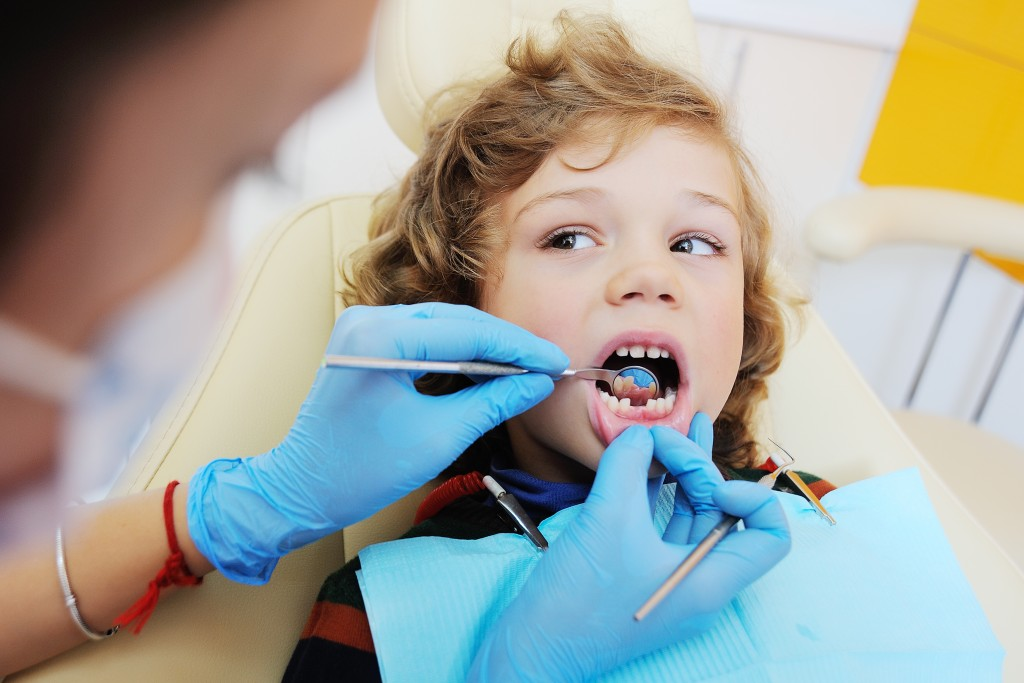 child in dental clinic