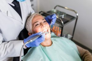 elderly woman getting teeth cleaned