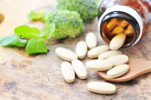 Food supplements with wooden spoon