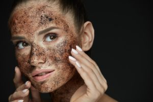 Woman using a face scrub