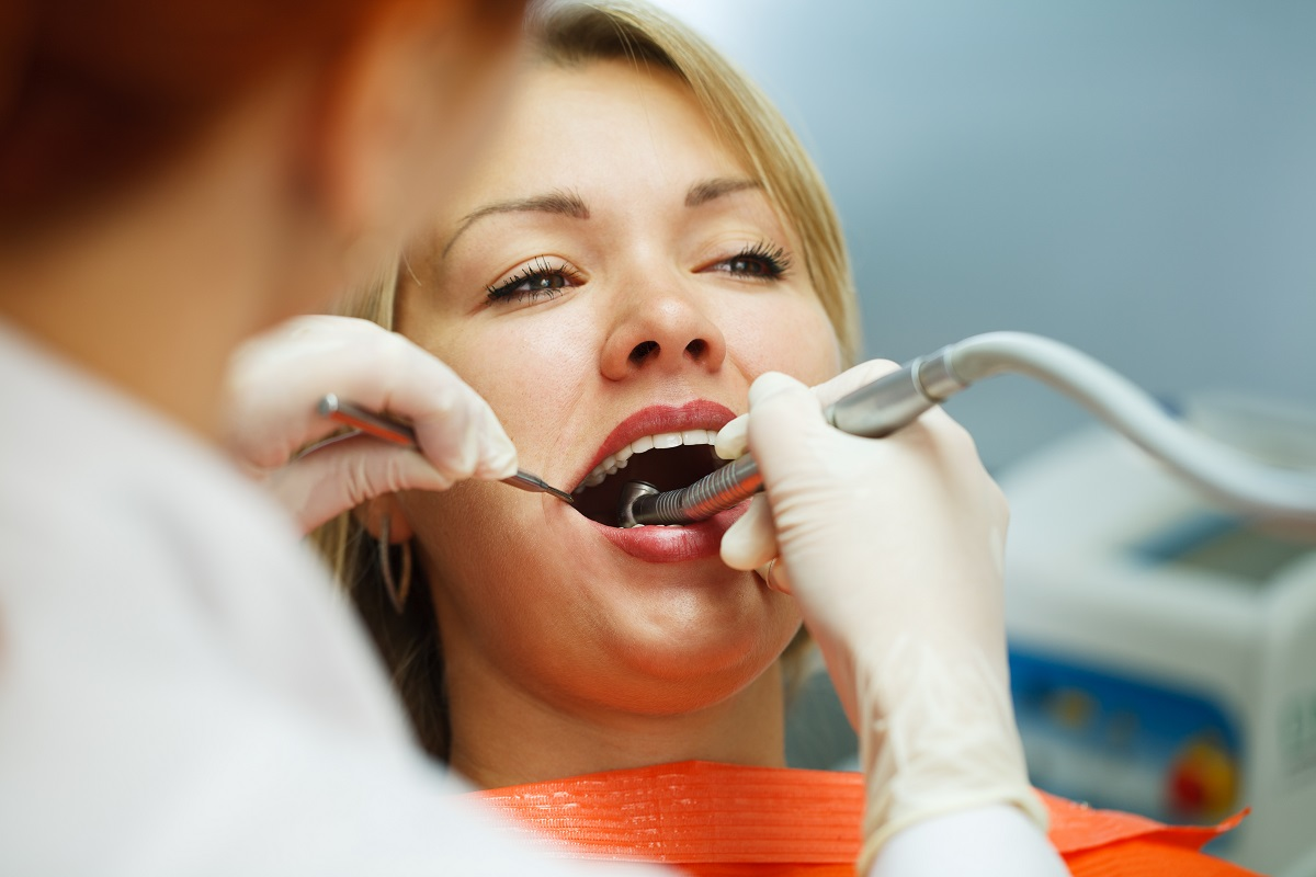 woman having her teeth clean