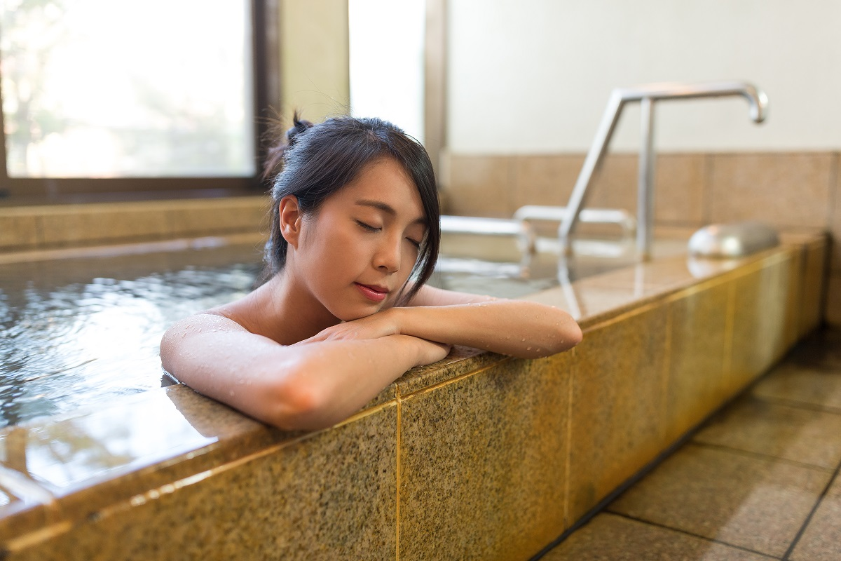 woman relaxing at a bathtub