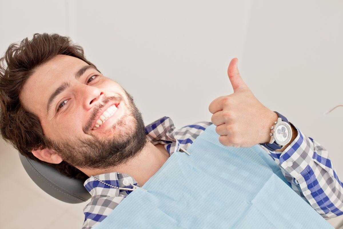 man smiling thumbs up