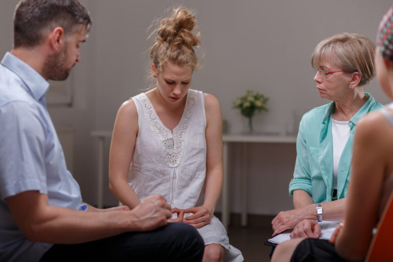 woman sharing at a support group