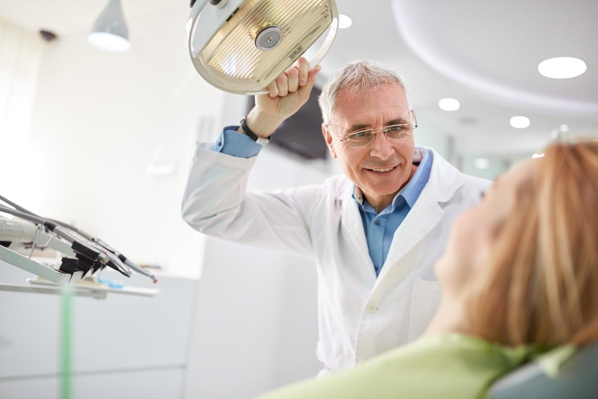 dentist adjusting searchlight